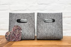 Grey felt storage box with handles. You may use those boxes as storage boxes in your wardrobe or simply on the shelves. They keep their shape even if