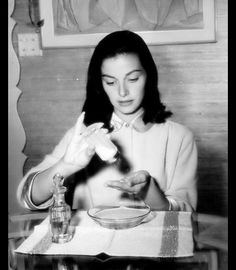 Pier Angeli doing her nails