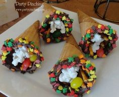 cone dipped in chocolate, rolled in fall colored sprinkle leaves and filled with goodies for the kids on Thanksgiving..