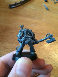 Deathwatch iron hand armed with power axe and plasma pistol