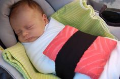 newborn sushi- I think with a white blanket, pink small pillow, and black fleece...easy enough