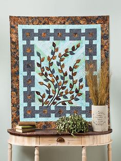 Friends & Family ~ Simple applique over a strip-piece background makes a beautiful quilt that can also be used as a family tree or signature quilt.