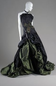 Alexander McQueen. Strapless evening dress. Black and green silk taffeta, glass, and leather. Fall 2007, In memory of Elizabeth Howe, Salem 1692, England. Lent by Alexander McQueen