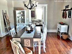 dark wood floors, tan walls, white trim and black accents. Dining Room Storage, Kitchen Dinning Room, Dining Room Design, Dining Area, Tan Walls, Front Rooms, Up House, Home Kitchens, A Table