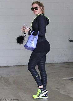 Sweating it out: Khloe looked happier as she headed to the gym in the early morning hours...
