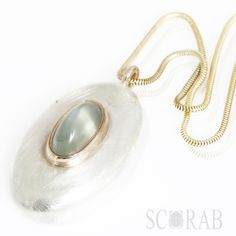 Scarab surfs the moon: 9ct gold and silver moonstone 'surfboard' pendant, completely drool worthy.