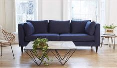 Maxim 2.5 Seater in Linen Look Navy 29. Please note this Sofa is an Ex-Display sofa with some signs of showroom use.