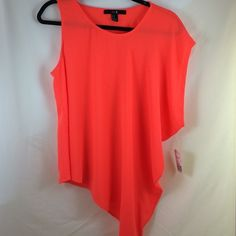 Asymmetric neon top Neon top cut with asymmetric sleeves and hem. Brand new! Forever 21 Tops