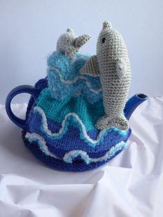 Nice warm teapot cosy for tea lovers! Sea and dolphins jumping on the waves. Fits 4-6 cup teapot. Thanks for stopping by.