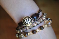 I love stackables!  This beautiful piece is made of leather, crystal beads, wood beads and my favorite...vintage buttons from the button tin.