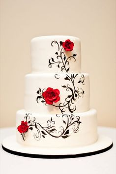 Hand painted Black and White Wedding Cake - Fondant covered cake with hand painted design and gum paste roses.
