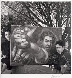 David Alfaro Siqueiros [realist painter, known for his large murals in fresco] and his wife Angélica Arenal with Siqueiros' self-portrait (El Coronelazo), Mexico, 1945 Photographed and signed by Horst P. Horst.