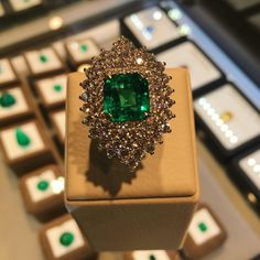 Unconditional love for this beautiful beautiful Colombian Emerald ring set with Diamonds around it. A unique and fabulous design makes the emerald shine and brings the best of Green.