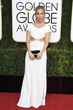 Sienna Miller wearing white long cut out dress and pearls at Golden Globes 2017.