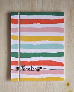 "This colorful striped paper has been cut and popped up on a card base to create a slitted pocket of white.  Before cutting, stamp or write ""thanks"", so the black line carries over on both parts of the slit.  Handmade thank you card."