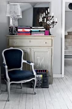 Loving the combination of furniture here (not the candle holder nor the light fixture). I am crazy about the monogrammed dresser.