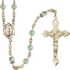 14kt Gold Filled Rosary features 6mm Crysolite Swarovski, Capped Our Father beads. The Crucifix measures 1 7/8 x 1 1/8. The centerpiece features a Miraculous me