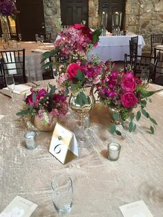 Wedding Flowers. Ceremony Centerpieces. Gold mercury Vases. Gold mercury stands. Pink and Gold. Pink Flowers. Pink Hydrangea. Pink roses. Antique Hydrangea. Seeded Eucalyptus. Tablescape. Table centerpiece. Clustered flowers. Clustered arrangements. Gold and Pink. Bold Pink flowers.