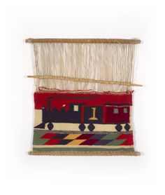 "Navajo pictorial weaving sampler of a train with the number ""1,"" 1885-1890. From the Lucke Collection."