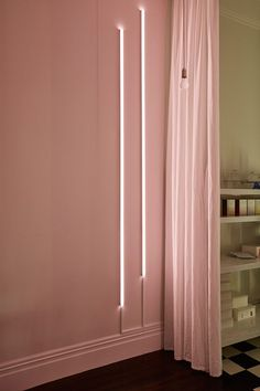 blush walls with minimal vertical lighting