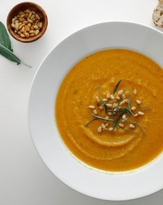 Butternut Squash + Red Lentil Soup... Rich in protein and lightly flavored with sage, this one pot soup is so healthy, easy and simple. Can be made a day or two ahead and reheated as needed for holiday gatherings.