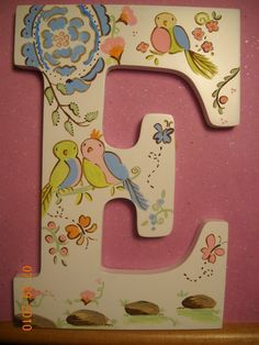 Love birds nursery theme baby name wooden letters. $90.00, via Etsy.  I like the idea of painting a picture on the letter..OK this is way cool!! @Rami Williams