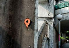 designer shuchun hsiao has created a series of birdhouses modeled after the google maps destination icon, and placed them all over urban locations in china.
