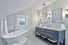Beautiful bathroom. Love the freestanding tub and how accessible the towels are underneath the vanity