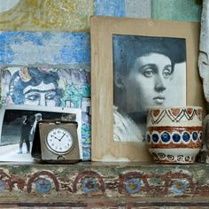 Duncan Grant's Studio mantelpiece (detail) Photograph of a young Vanessa Bell by George Beresford.