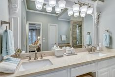 Dazzle vanity lighting by Progress Lighting; image courtesy of West Point Homes