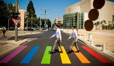 Urban intervention reaches out to the people, Tel Aviv, Israel is getting ready for the city's annual gay parade as they paint their pedestrian crossing in the colours of the gay pride flag.
