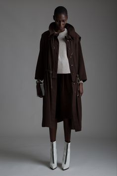 Vintage Issey Miyake Coat, Maison Martin Margiela Sweater and Yves Saint Lauren Velvet Skirt. Designer Clothing Dark Minimal Street Style Fashion