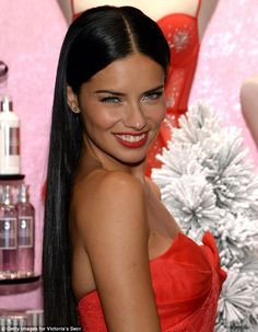 Adriana Lima in NYC. Matching red lips, dress and nails.