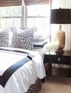the textiles << modern brown white gold bedroom ... I would use black, white, and silver, but I like the simplicity