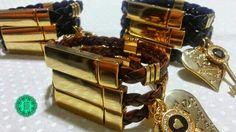 Trio de pulseiras com pingente chave e coração.