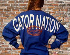 This item is unavailable Florida Gators T Shirt, Florida Girl, Spirit Shirts, Spirit Jersey, Football Outfits, Sporty Girls, Softball Coach, Softball Stuff, Football Season