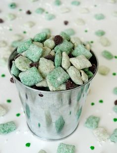 Bailey's Irish Cream Puppy Chow:  5 cups rice chex cereal, divided~  5 oz white chocolate or white vanilla candy melts~  5 oz green candy melts (Found in craft stores like Michaels and Hobby Lobby)~~  4 tbsp Bailey's Irish Cream, divided~  1 cup powdered sugar, divided~  1 cup chocolate chips~
