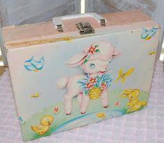 Vintage, worn, baby lamb suitcase