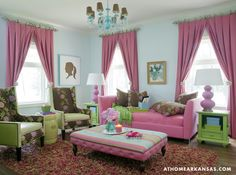 love the curtains + chandelier... via In the girls' den, a Lee Industries sofa, ottoman and chairs covered in Pine Cone Hill fabrics add comfortable seating for the girls and their friends. A Robert Abbey lamp, Duralee curtains, Tobi Fairley Collection silhouettes and Rug Market rug complete the space.