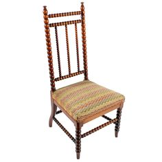 Victorian Walnut 'Bobbin' Turned Chair   An early 19th century Victorian walnut 'Bobbin' turned chair.  The chair has a high back made up from bobbin turned rails and a seat covered in a 19th century needlework upholstery.  The chair's front legs and cross stretchers are turned to match and the back legs are nicely shaped, turned and kick out.  The chair has a lovely original colour to the walnut and is in very good condition.  The upholstery was removed to replace the webbing and then… Antique Bedroom Furniture, Antique Chairs, 19th Century, Needlework, Armchair, Upholstery, Dining Chairs, Victorian, Colour