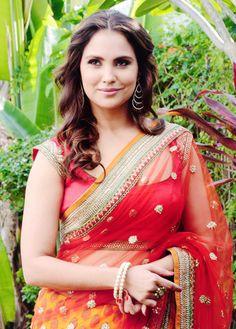 Lara Dutta in a red saree