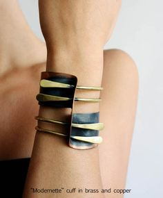 Art Smith bracelet (direct link, http://artsmithjewelry.com/asdirectory.html).