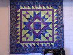 "Heirloom quilted table topper table runner lap quilt or wall hanging in blue, purple and green, peacock feather borders $95.00 USD  by SusansPassion 42.5"" square"