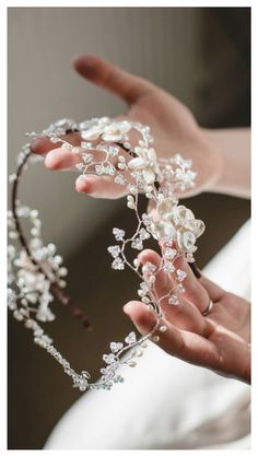 May Blossom Double Headdress by Hermione Harbutt. Delicate, pretty and simple with a light floral design. A beautiful wedding headband.