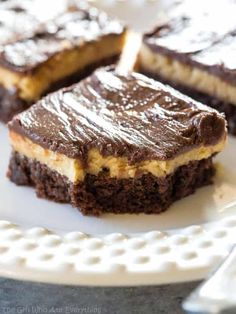 Buckeye Brownies Recipe - The Girl Who Ate Everything- Buckeye Brownies Recipe – The Girl Who Ate Everything Buckeye Brownies with a rich brownie layer, a creamy peanut butter layer, and topped with another chocolate layer. The ultimate indulgence! Cookie Desserts, Just Desserts, Delicious Desserts, Dessert Recipes, Bar Recipes, Party Desserts, Dessert Ideas, Cooking Recipes, Healthy Recipes