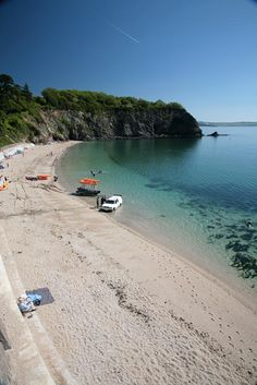 Porthpean Beach, St Austell, Cornwall. Crystal clear waters make this Cornish beach perfect for snorkling and diving.