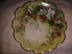 Limoges French Holiday holly plate with gold trim.Hand painted- 12 inch in diameter - Circa 1900- Limoges France