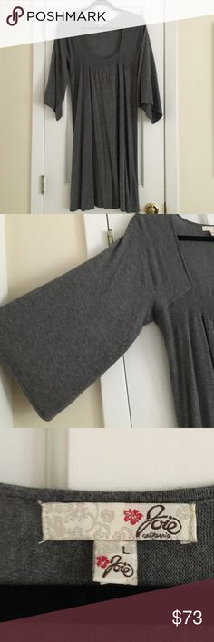 Joie Grey Sweater Dress Joie grey sweater dress. Size large. Has a band detailing going across the dress. Wide sleeves. Falls to around the knee. Material is 40% nylon, 35% rayon, 20% wool, and 5% cashmere. No stains or holes. Very minor pilling under the arm (as pictured) but hardly noticeable. Excellent used condition and perfect for fall! Joie Dresses