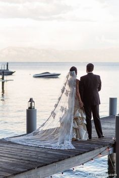 Wedding at the lake wedding dress water outdoors boat bride groom