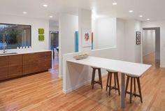 Open-plan kitchen & casual dining. Bright, white & modern. Walnut cabinets. White Quartz countertops. Vanillawood design/build.